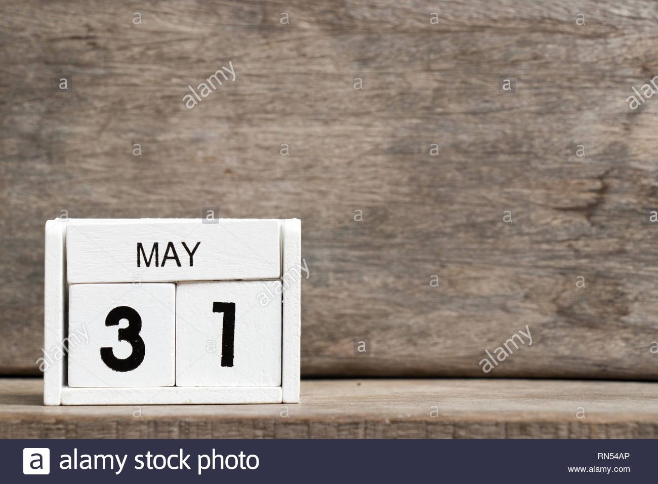 White Block Calendar Present Date 31 And Month May On Wood